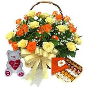 Basket of 20 orange and yellow roses half kgs. assorted mithai and 6 inches teddy