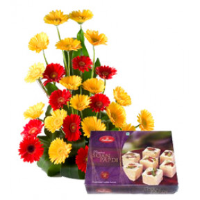 Sweet Basket of 12 Red and Yellow Gerberas with 500gm Soan Papdi.