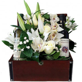 White Flowers And Wine In Leather Chest