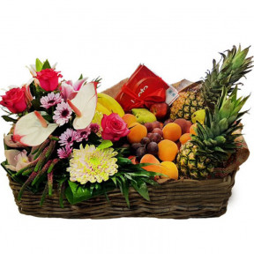 Basket Filled With Flowers, Fruits And Chocolate