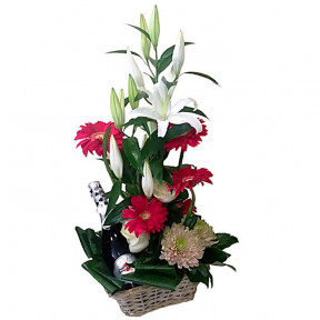 Basket With Sparkling Wine And Flowers