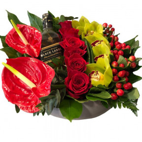 Floral Arrangement With A Bottle Of Whiskey