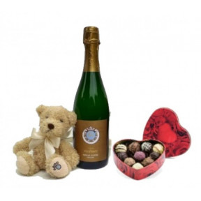 Sparkling Wine, Chocolates And A Bear