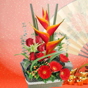 Heliconia And  Red Roses Table Arrangement