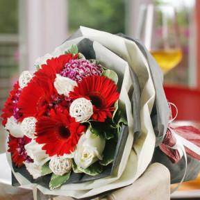 Gerbera, White Roses And  Twig Balls Handbouquet