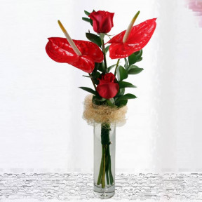 Red Anthurium And  Roses In Glass Vase