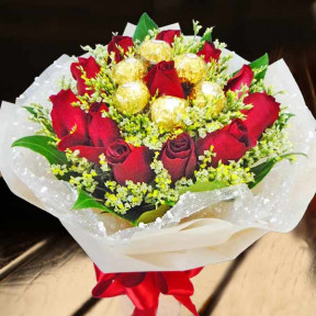 12 Red Roses With Rochers Hand Bouquet Delivery