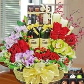 Wines, Chocolates And  Red Roses Basket Arrangement