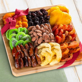 Dried Fruit Assortment With Almonds On Bamboo Cutting Board Serving Tray With Handles