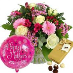 Mixed Flowers In A Vase, Chocolate Box And A Balloon