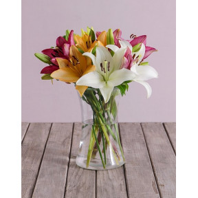 Lush Lilies In A Clear Vase (12 Lilies)