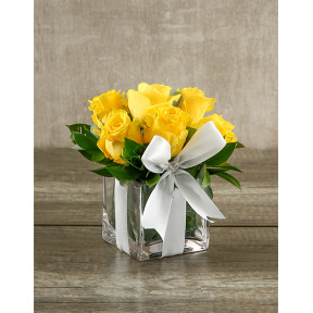Yellow Roses In A Small Square Vase