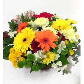 Flower arrangement with a basket of gerberate, ancillary flowers and grapes (Classic)
