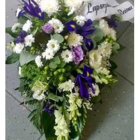 Funeral arrangement of white and purple flowers