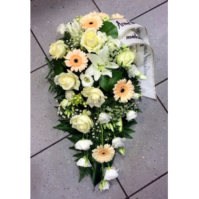 Funeral arrangement in white and creamy shades: rose, lilys, gerberas