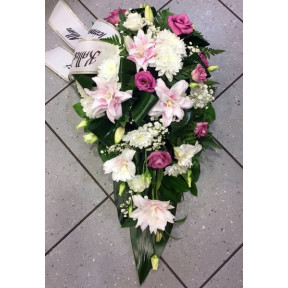 Funeral arrangement: lilys and pink spices
