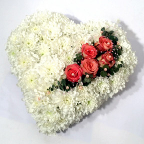 White heart-shaped arrangement of chrysantemums