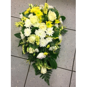 Funeral arangement: white roses, white and yellow chrysantemums