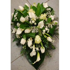 Funeral arrangement of white callas and tulle
