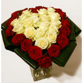 Heart-shaped bouquet of red and white roses