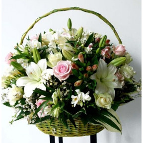 Big basket of white and pink flowers; Lilys, Roses, Fresias etc