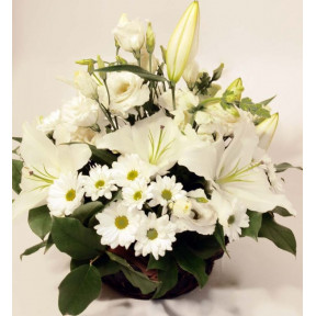 Basket arrangement of white blooms: Lilys, Roses, Chrysantemums