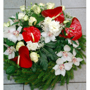Funeral wreath: red anthuriums, white roses and orchids