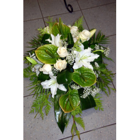 Funeral arrangement of white roses, lilys and anthuriums