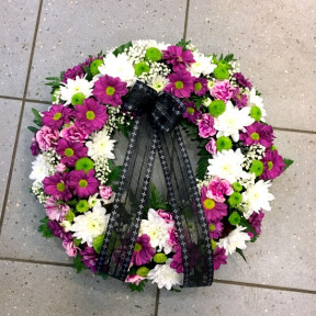 Small wreath in white, lilac and green colors