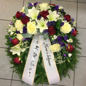 Wreath: White lilacs, white and red roses, lilac irises and lilacs
