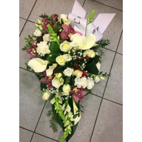 Funeral arrangements: dark orchids, white roses, lisianthus and callas