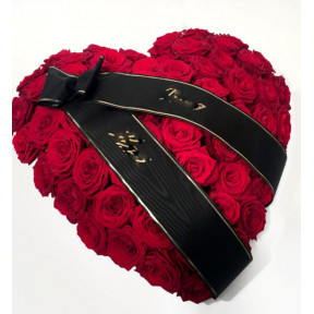 Heart-shaped arrangement for the funeral (red roses)
