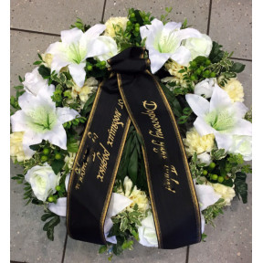 Funeral wreath with artificial flowers