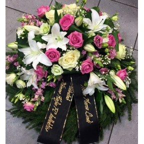 Large funeral wreath: pink and white roses, lisianthus, lilys