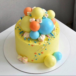 Whimsical Yellow And Blue Design Cake