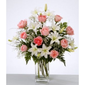 Flower Arrangement In Vase With White Lilies And Pink Roses