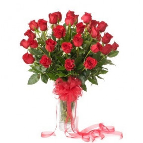 Three Dozen Roses In A Glass Vase