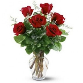 Arrangement Of Six Roses In A Glass Vase