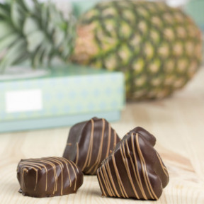 Fresh pineapple in dessert chocolate