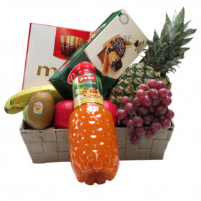 Fruit basket with fruit juice biscuits and chocolate