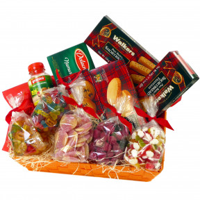 Candy basket with fruit juice, cookies and soft candies