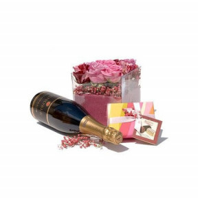Arrangement of roses, chocolates and sparkling wine